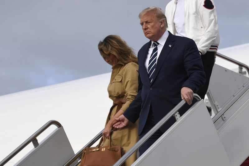 Donald Trump again rebuffed trying to hold Melania's hand, but hold on…